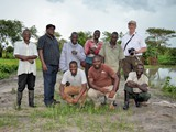 Group photo at the ponds of the community in Mjinchi